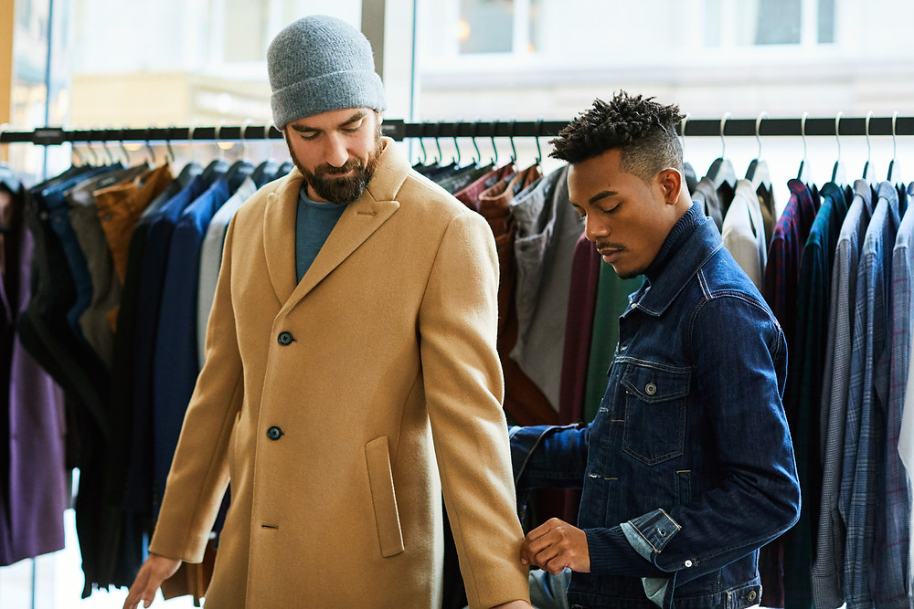 a stylist at fashion retailer Bonobos attends to a customer