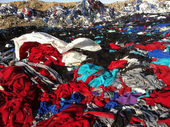 landfill full of fast fashion clothing
