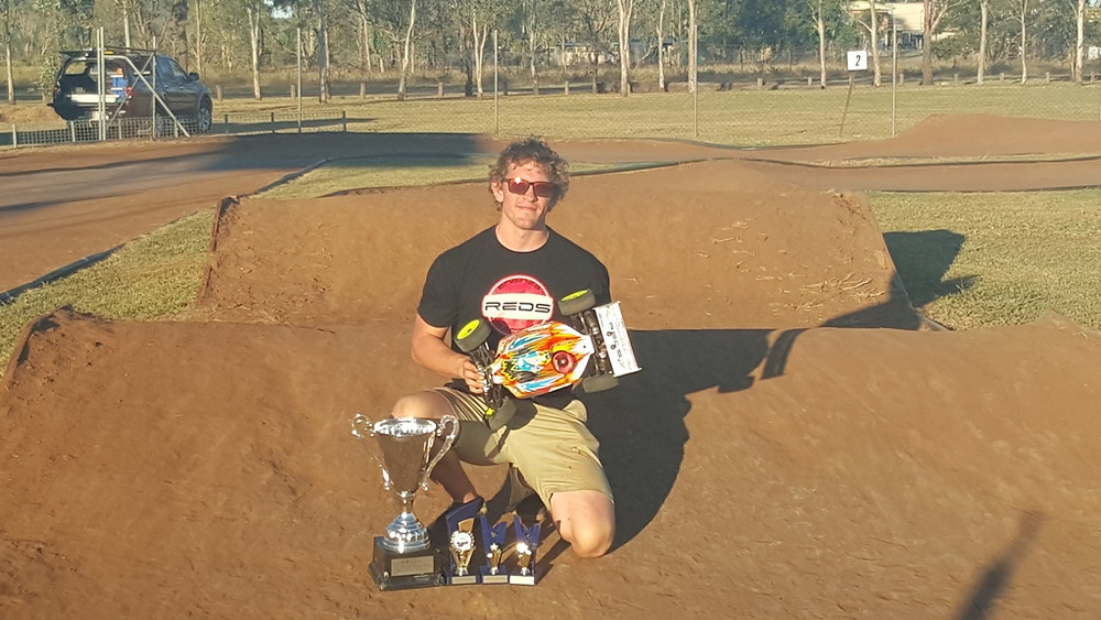 aaron stringer takes the win reds racing.jpg