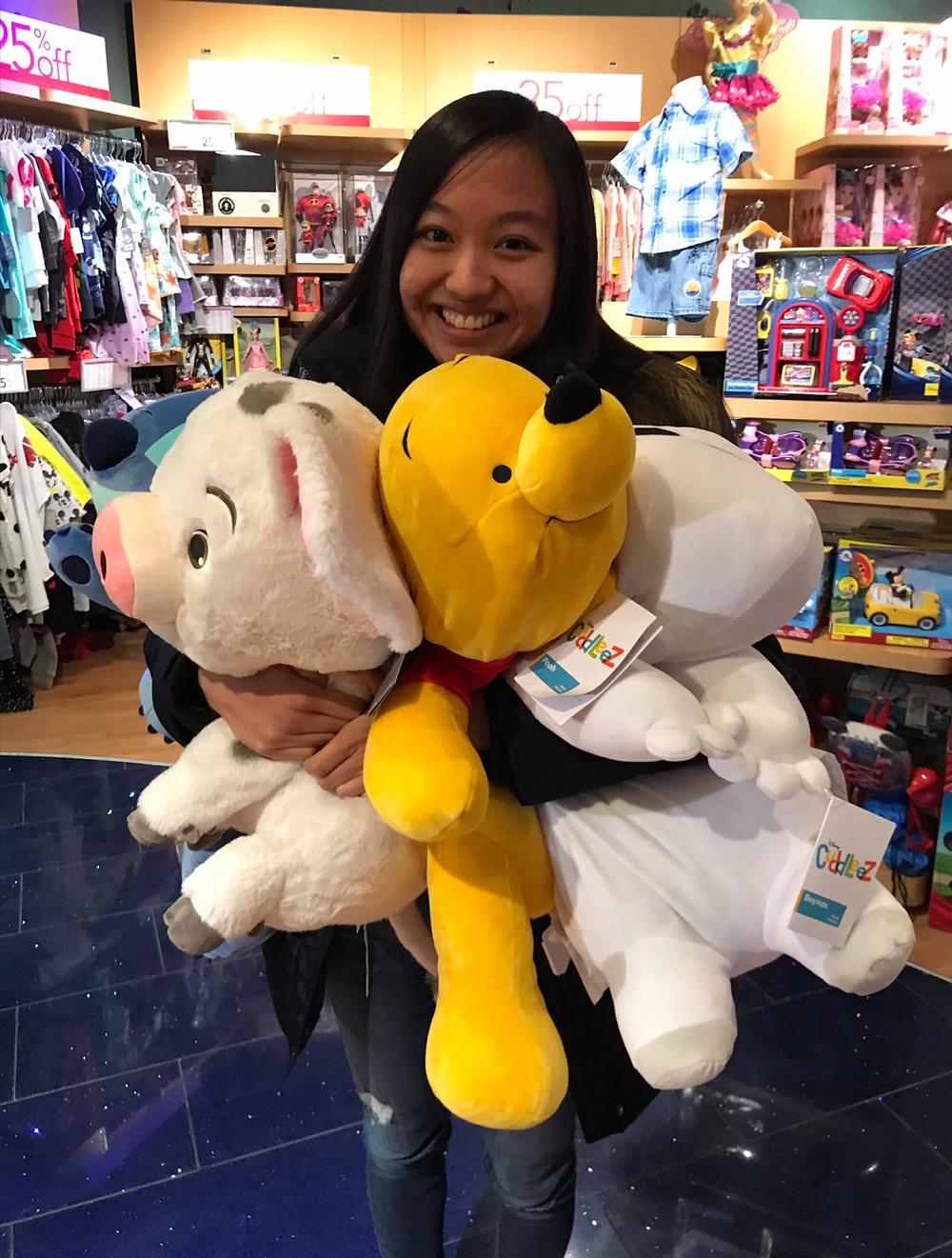 Casey holding 3 stuffed animals
