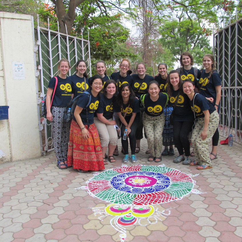 Everyone in front of the entrance to the school with the welcome rangoli!