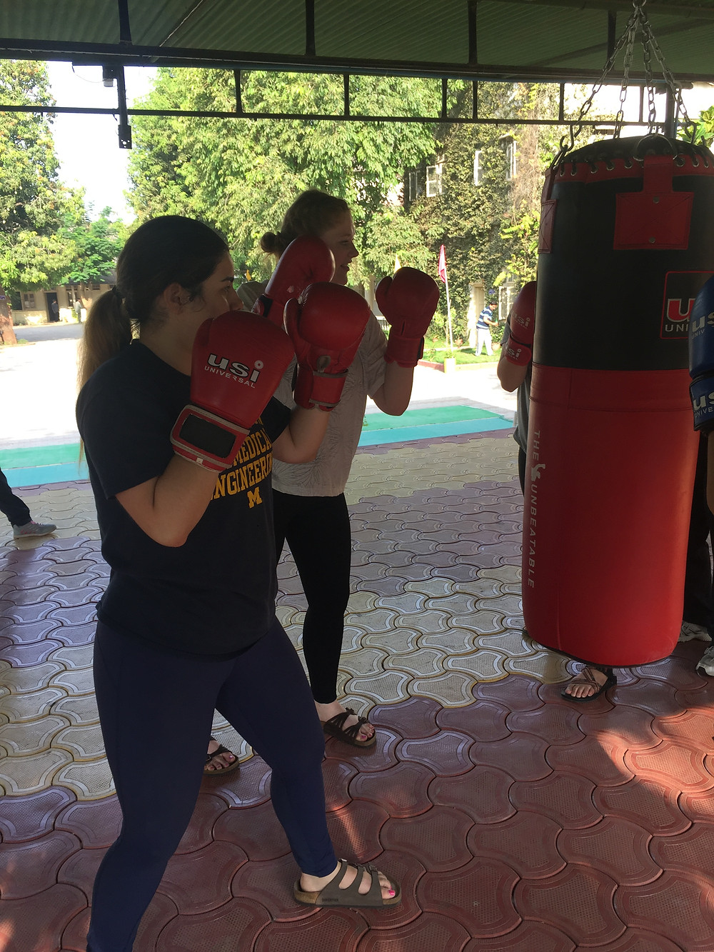 Melissa and Leah practicing their natural boxing skills before taking on Principal Sir