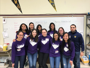 Group picture in purple ASB shirts in the classroom
