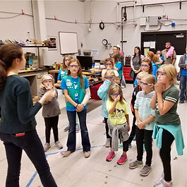 Girl scouts tour a lab