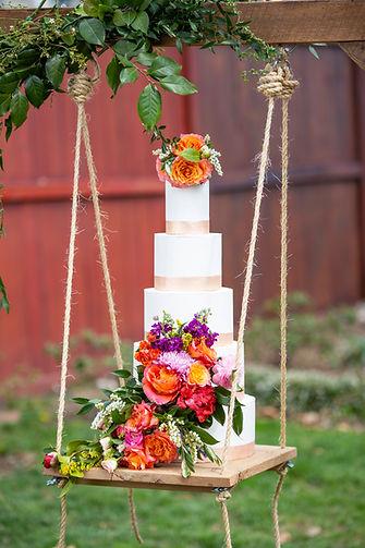 Roanoke VA custom wedding cake bakery Bent Oaks Manor wedding venueFloral wedding cake hanging cake stand