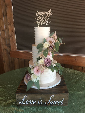 Pleated buttercream wedding cake with fr
