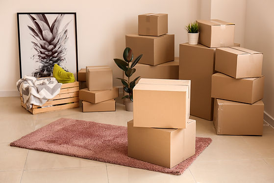 Moving boxes with belongings in empty ro