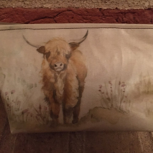 Handmade small oilcloth highland cow makeup bag