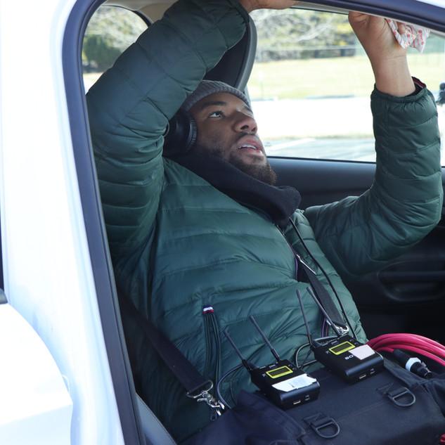 Markel Hawkins, Assistant Sound Recordist, fitting audio into BUMMER car