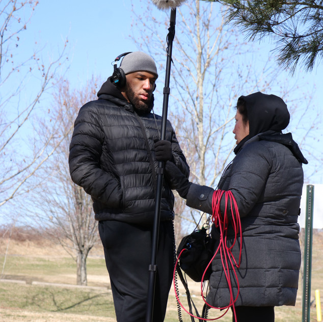 Markel Hawkins, Assistant Sound Recordist, and Pamela Xing, Sound Recordist, on set for BUMMER