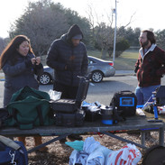 Pamela Xing, Sound Recordist, Markel Hawkins, Assistant Sound Recordist, and Barry Worthington, Director, with gear on set for BUMMER