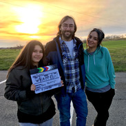 Barry Worthington with Hope Perry and Marili Mejias, wrapping BUMMER