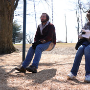 Barry Worthington, Director, and Mitra I Arthur, Assistant Director, between takes on swing set on BUMMER