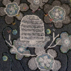 Hooked rug, black and white beehive