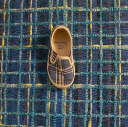 hooked rug, plaid with child's shoe