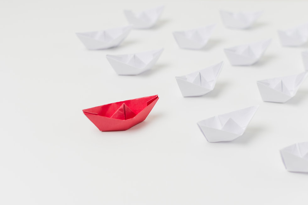 origami-boats-representing-leadership-co