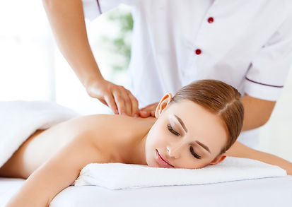 A woman getting a Massage and muscle pain relief from Dr. Sarah Chester at Marco Chiropractic