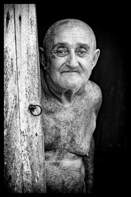 _E7A9478 Man with no shirt standing in doorway Trinidad B&W.jpg