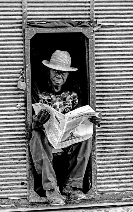 _E7A6245 Man reading paper in small doorway B&W.jpg