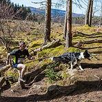Man running wit dog
