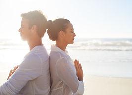 Couple Meditating on the Beach_edited.jp