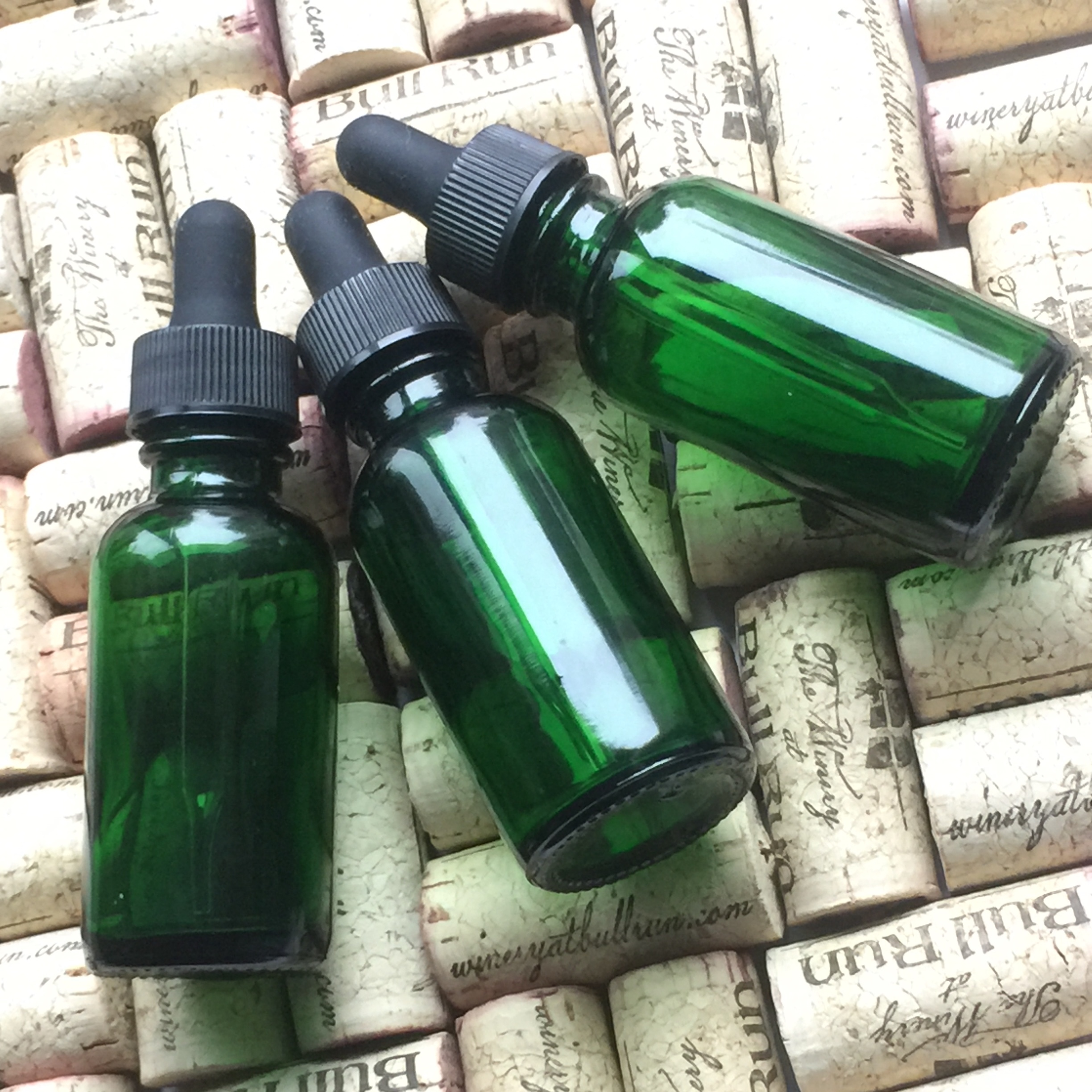 Green glass dropper bottles