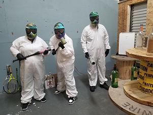 3 people ready to break stuff at fellow earthling rage room