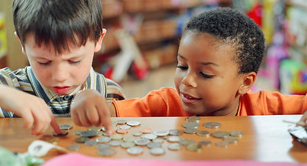 kids-counting-coins-on-store-counter.jpg