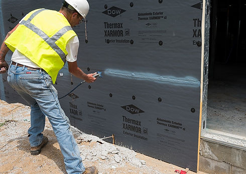 builder-completing-the-thermax-wall-system-dow-40194502843-1250x700_edited.jpg
