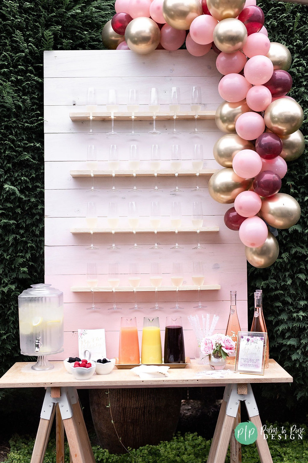 champagne wall and pink balloon garland