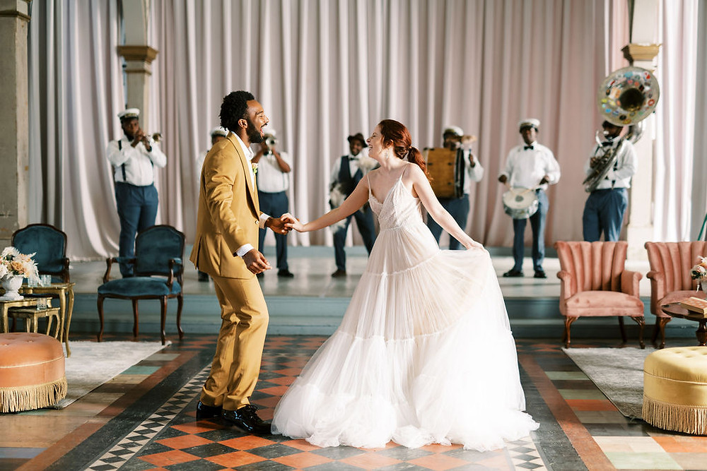 Bride, Groom, and Second Line Band for Bridgerton Inspired Wedding at the Marigny Opera House in New Orleans with Lounge Spaces and Vintage Furniture by Lovegood Rentals