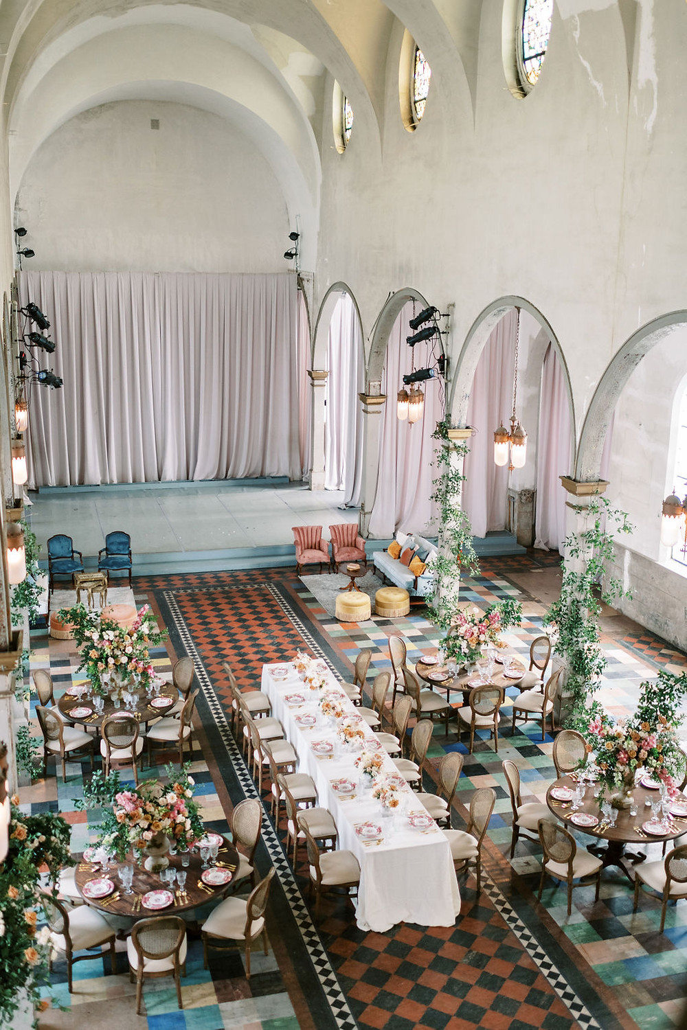 Seated Dinner for Bridgerton Inspired Wedding at the Marigny Opera House in New Orleans with Decor, Lounge Spaces, and Vintage Furniture by Lovegood Rentals Featuring Caned Louis Chairs, Mahogany Round Tables and Overgrown Florals