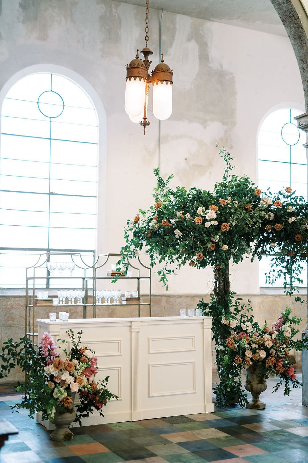 Bridgerton Inspired Wedding at the Marigny Opera House in New Orleans with Decor, Lounge Spaces, and Vintage Furniture by Lovegood Rentals Featuring Antique Designed Bar, Barbacks w. Glass Goblets, Vintage Books and Overgrown Florals
