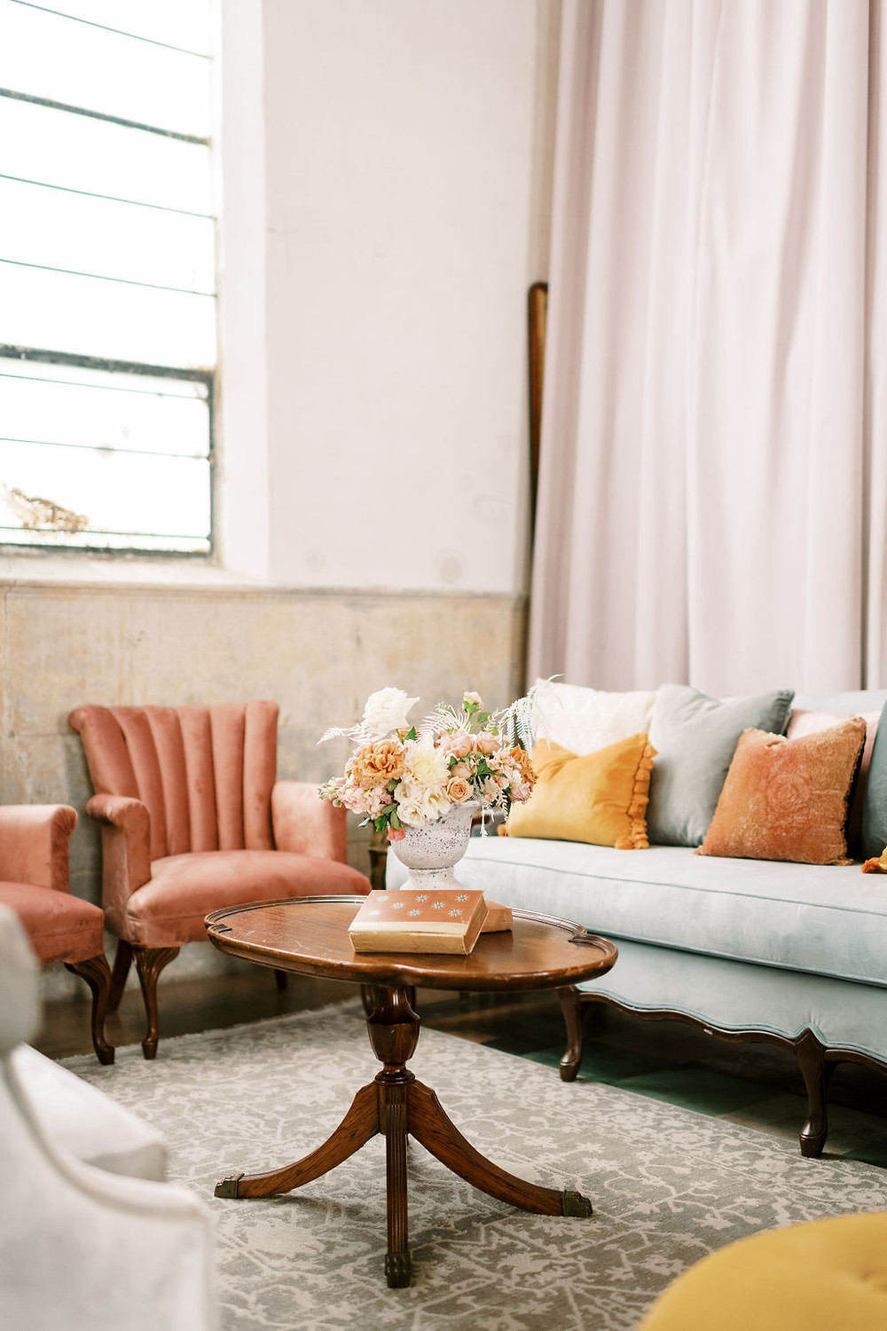 Lounge Space and Seating for Bridgerton Inspired Wedding at the Marigny Opera House in New Orleans with decor and vintage furniture by Lovegood Rentals with Assorted Antique Furniture