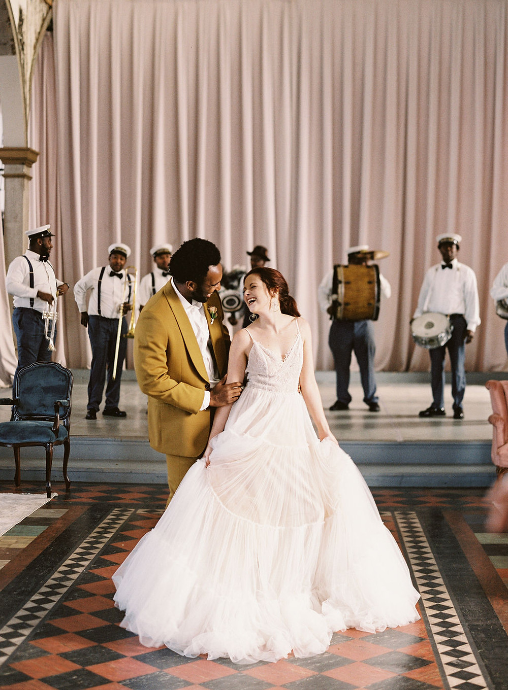 Bride and Groom with Kinfolk Brass Band for Bridgerton Inspired Wedding at the Marigny Opera House in New Orleans with Lounge Spaces and Vintage Furniture by Lovegood Rentals
