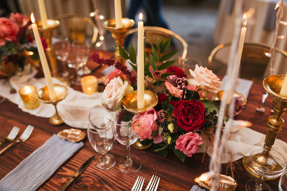 Lovegood Wedding & Event Rentals, New Orleans Vintage Rental Company for Corporate, Parties, and Weddings | Lounge Furniture in NOLA, Specialty Rentals, Decor across the Southeast, Classic Farm Tables with Candles and Florals