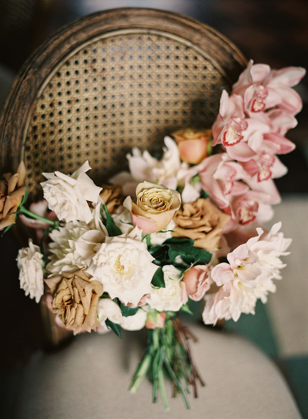 Bridal Bouquet on Barrett Louis Caned Chaired for Bridgerton Inspired Wedding at the Marigny Opera House in New Orleans with Lounge Spaces and Vintage Furniture by Lovegood Rentals