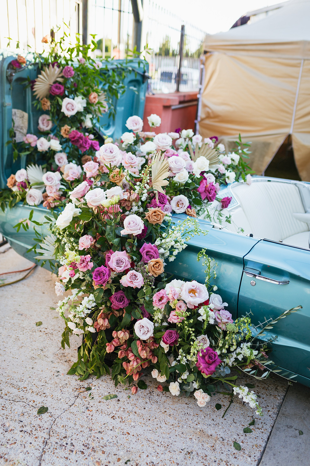 Lovegood Wedding & Event Rentals, New Orleans Vintage Rental Company for Corporate, Parties, and Weddings | Lounge Furniture in NOLA, Specialty Rentals, Decor across the Southeast, Vintage Car Covered in Florals