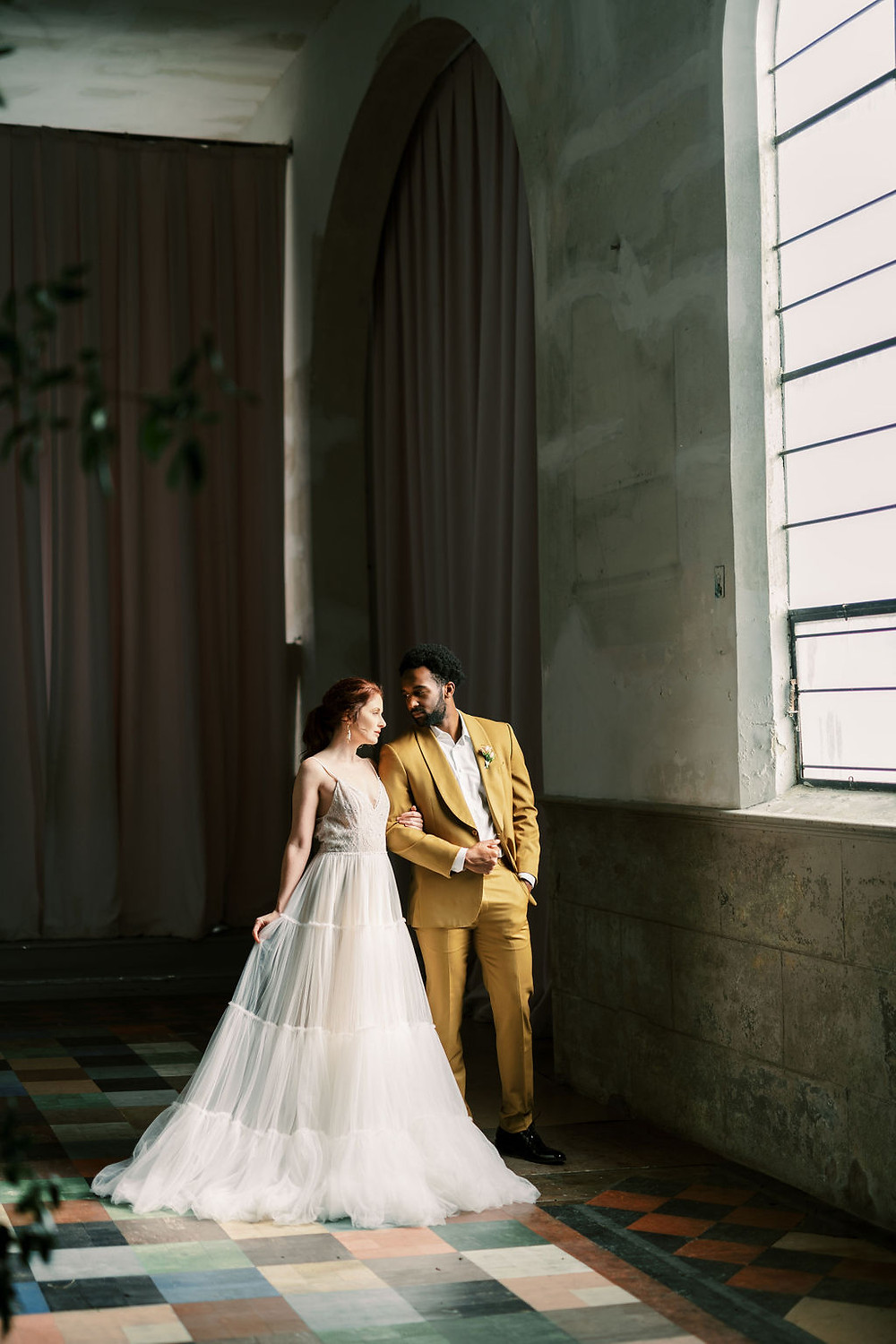 Bride and Groom for Bridgerton Inspired Wedding at the Marigny Opera House in New Orleans with Decor and Vintage Furniture by Lovegood Rentals