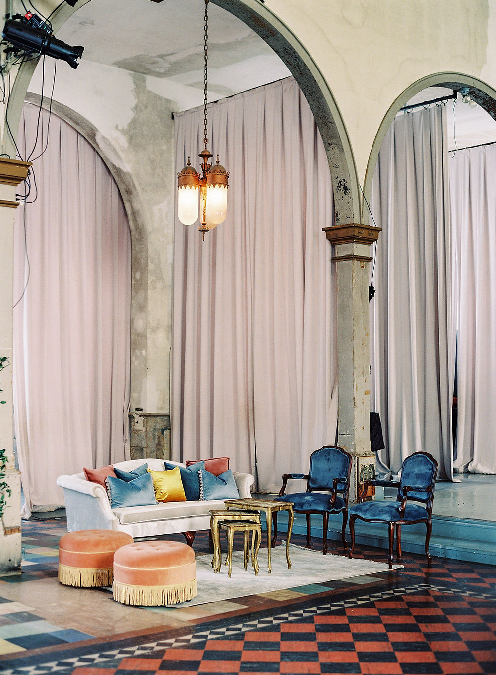 Lounge Space and Seating for Bridgerton Inspired Wedding at the Marigny Opera House in New Orleans with Decor and Vintage Furniture by Lovegood Rentals