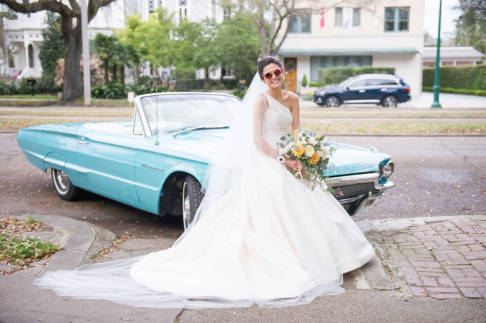 Il Mercato Wedding with Catherine Guidry Photography, Bee's Florals and Lovegood Rentals in New Orleans Lovegood Wedding & Event Rentals | Vintage, Specialty Rentals in the NOLA Area | Vintage Cars, Lounge Space, Playful Florals, Church Ceremony, and Beautiful Wedding Cakes