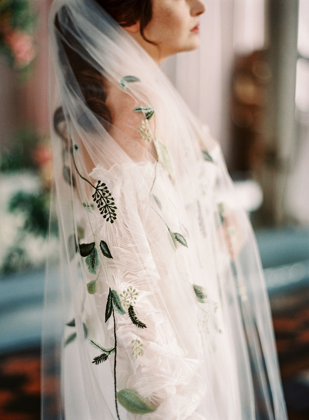 Bride with Floral Embroidered Bridal Veil for Bridgerton Inspired Wedding at the Marigny Opera House in New Orleans with Decor and Vintage Furniture by Lovegood Rentals