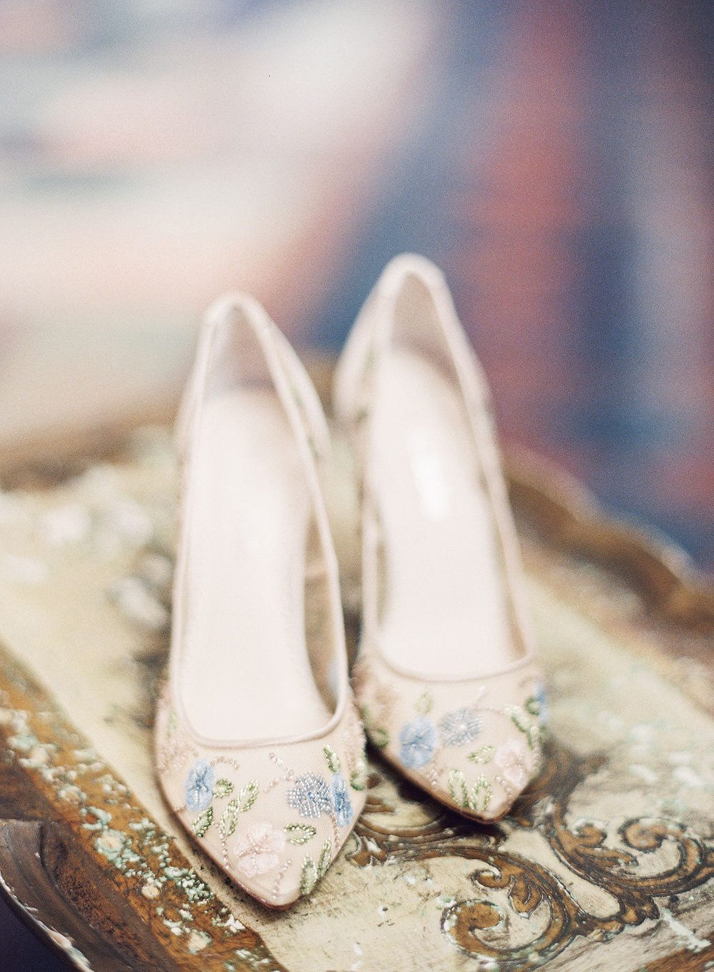 Floral Beaded Wedding Heels  on Antique Gold Side Tables for Bridgerton Inspired Wedding at the Marigny Opera House in New Orleans with Lounge Spaces and Vintage Furniture by Lovegood Rentals