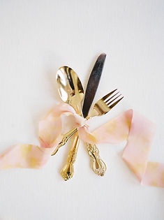 Gold Flatware with Peach and Yellow Died Ribbon | Lovegood Wedding & Event Rentals - New Orleans Furniture and Decor Company with Flatwear, Glasses, Ring Boxes, and More