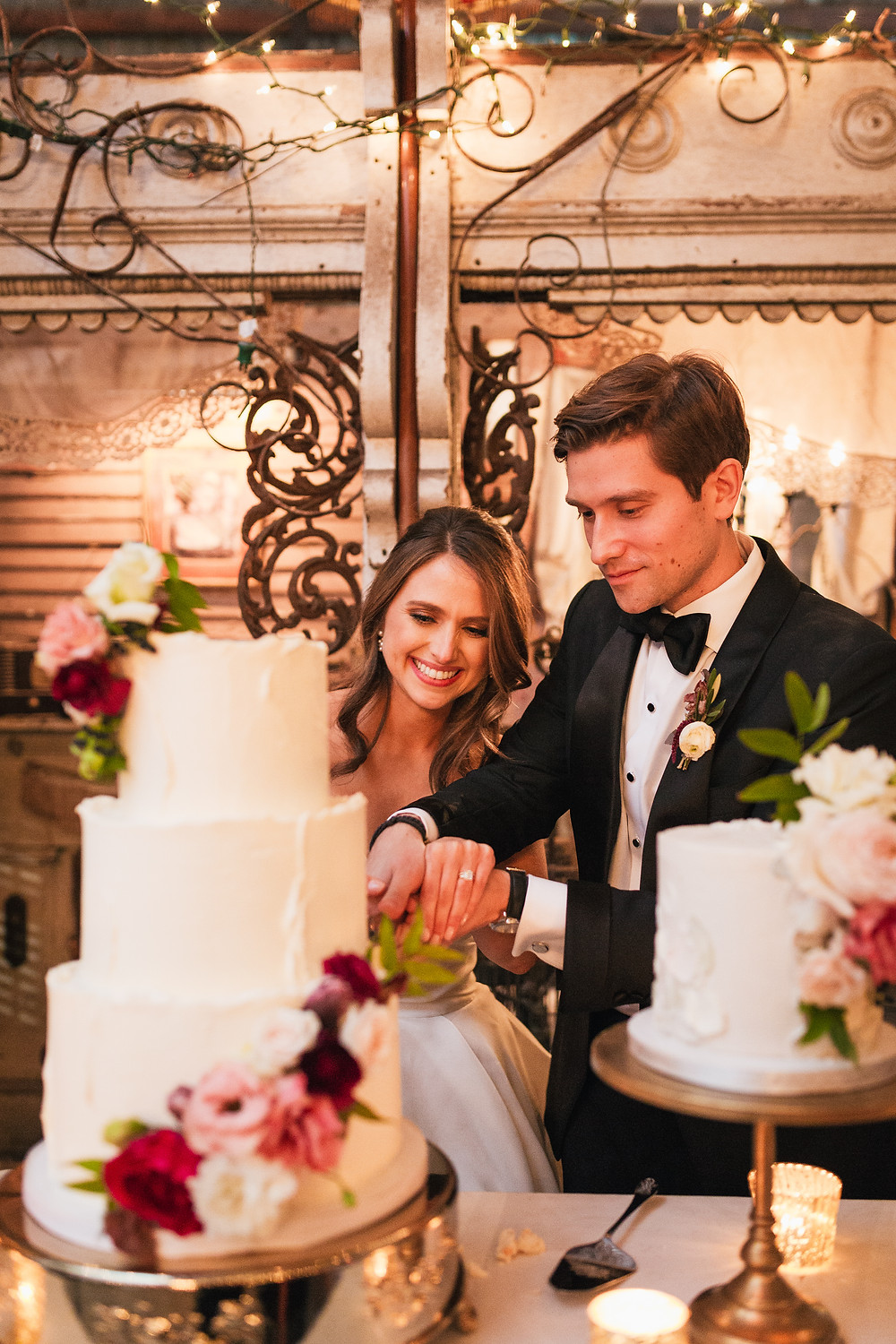 Lovegood Wedding & Event Rentals, New Orleans Vintage Rental Company for Corporate, Parties, and Weddings | Lounge Furniture in NOLA, Specialty Rentals, Decor across the Southeast, Old Warehouse Bride and Groom cutting the Cakes