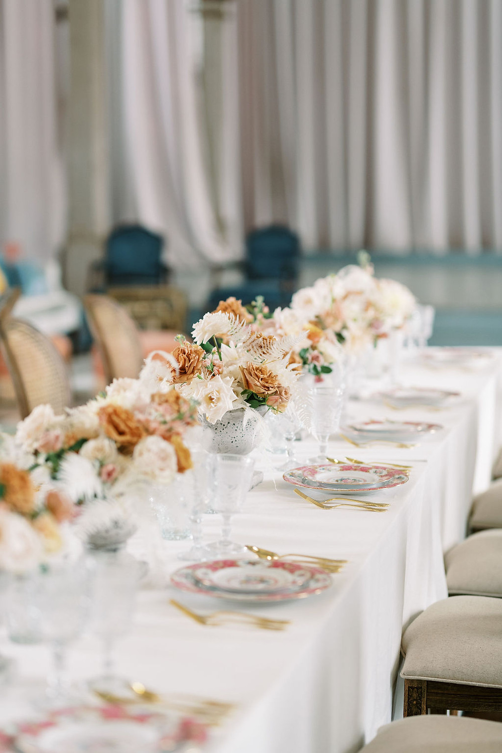 Seated Dinner for Bridgerton Inspired Wedding at the Marigny Opera House in New Orleans with Decor and Vintage Furniture by Lovegood Rentals Featuring Caned Louis Chairs and Linen Tables and Mixed Cream Florals