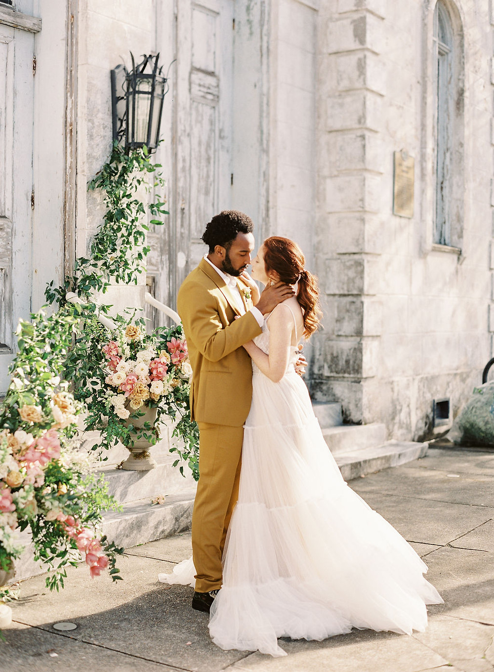 Bride and Groom for Bridgerton Inspired Wedding at the Marigny Opera House in New Orleans with Lounge Spaces and Vintage Furniture by Lovegood Rentals