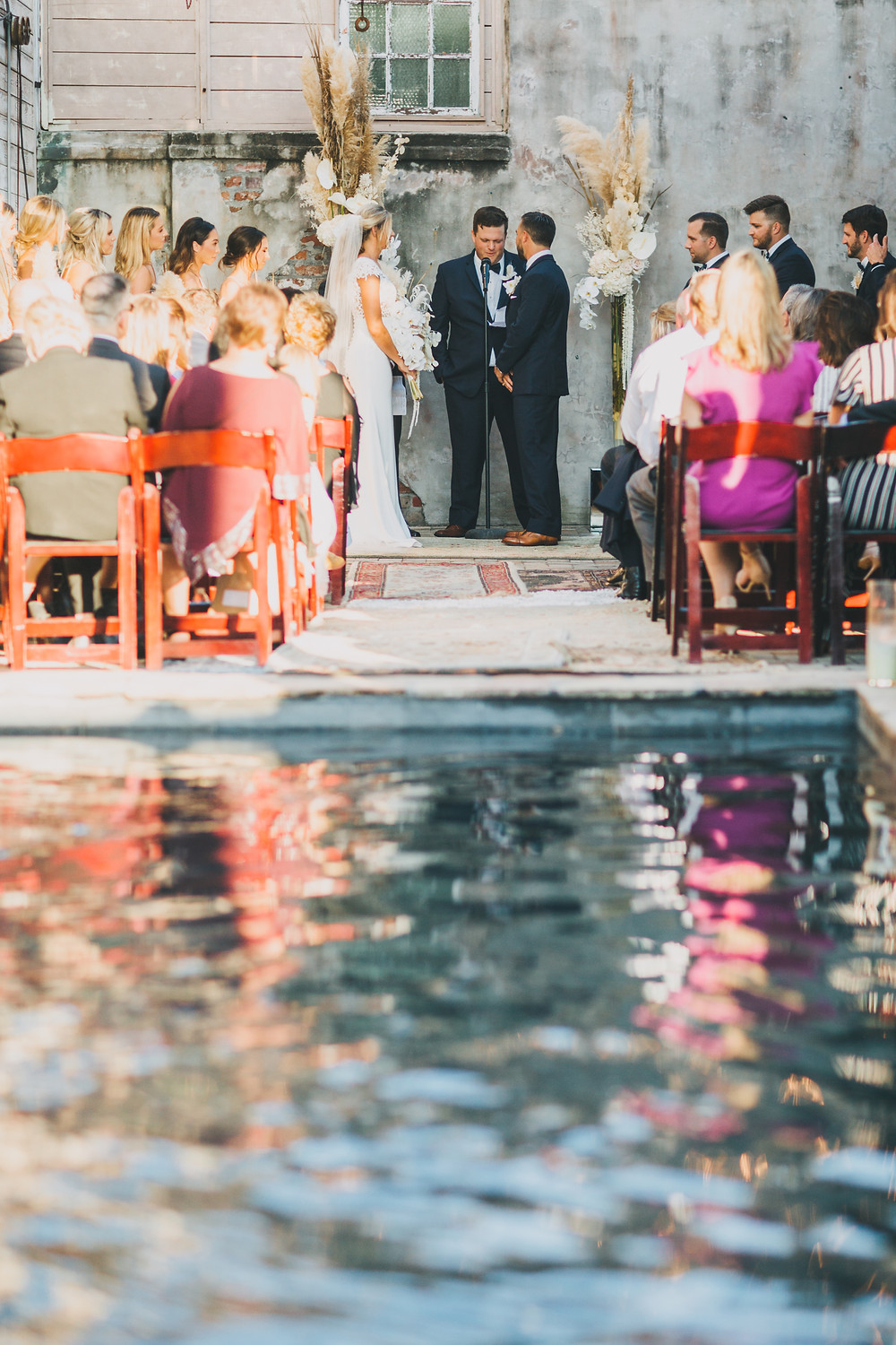 Lovegood Wedding & Event Rentals, New Orleans Vintage Rental Company for Corporate, Parties, and Weddings | Lounge Furniture in NOLA, Specialty Rentals, Decor across the Southeast, Boho Ceremony with Aisle of Rugs
