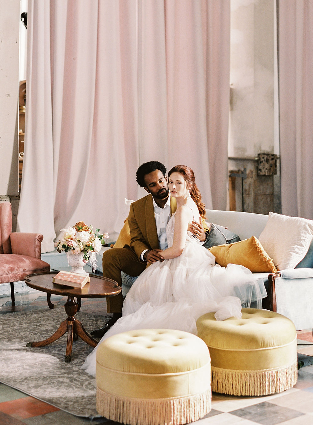 Bride and Groom on Lounge Space and Seating for Bridgerton Inspired Wedding at the Marigny Opera House in New Orleans with Decor and Vintage Furniture by Lovegood Rentals
