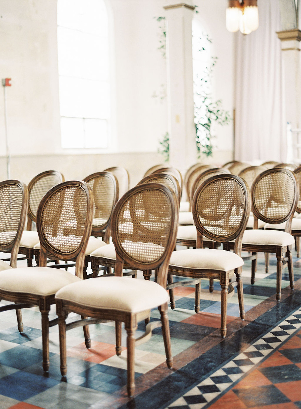 Caned Louis Chairs for Bridgerton Inspired Ceremony at the Marigny Opera House in New Orleans with decor and furniture by Lovegood Rentals